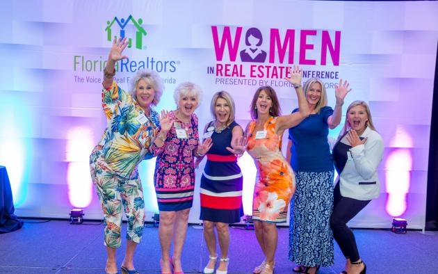 women in real estate conference attendees on stage