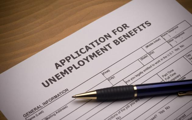 unemployment application and pen