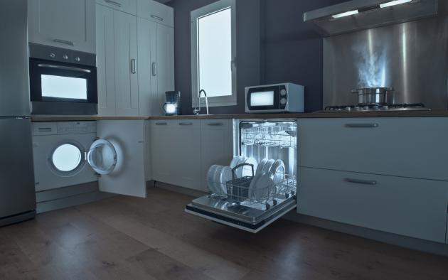 Kitchen with lights inside dishwasher, stove, washer and microwave