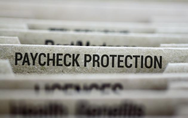File folder with paycheck protection in focus