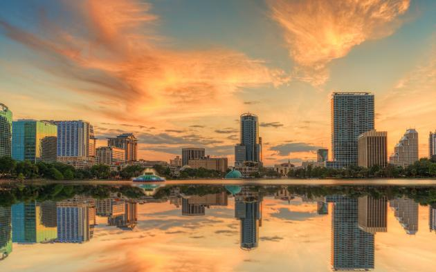 Orlando skyline at sunset with Lake Eola in the foreground