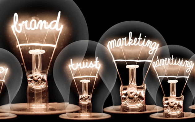 Photo illustration of lightbulbs with the words, brand, design, logo, marketing etc inside the bulbs