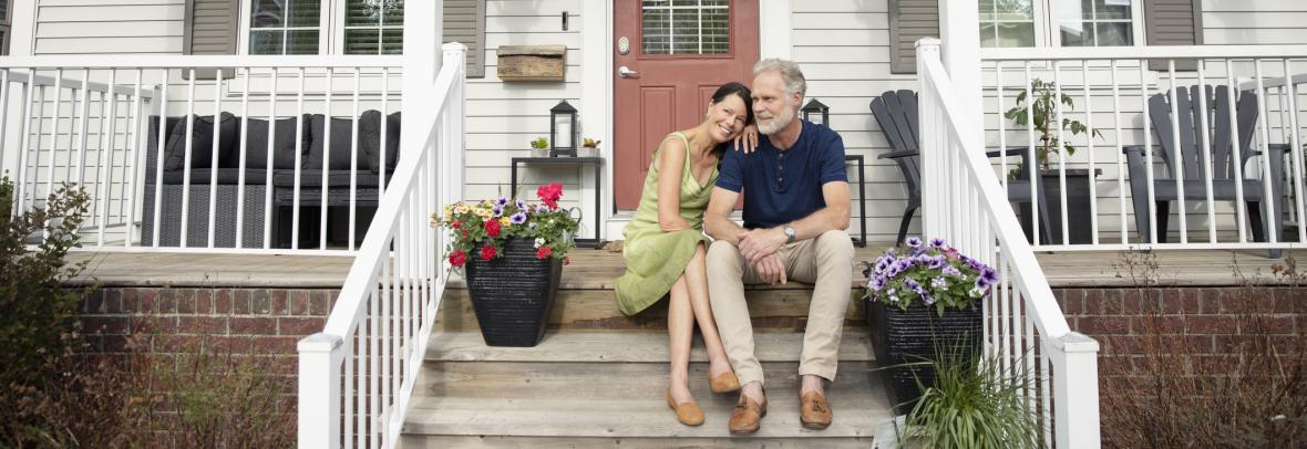 senior citizen couple sitting on porch