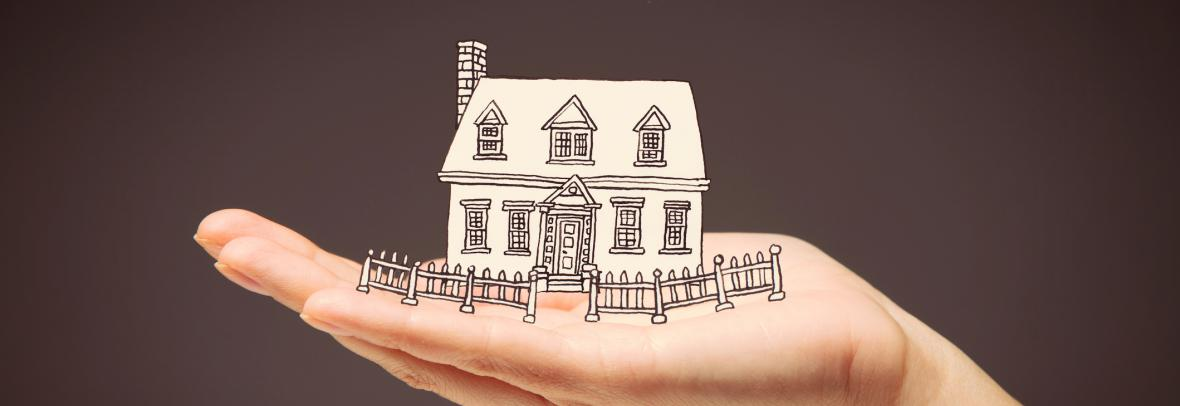 illustration of hand holding a house