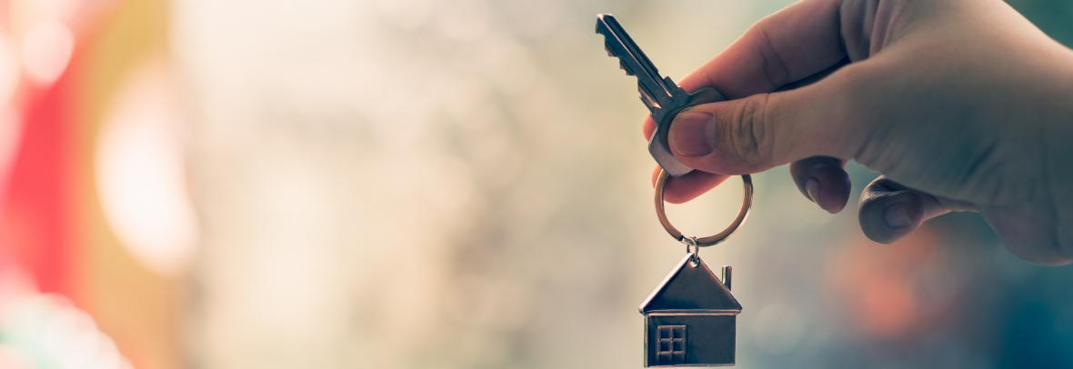 hand with house key