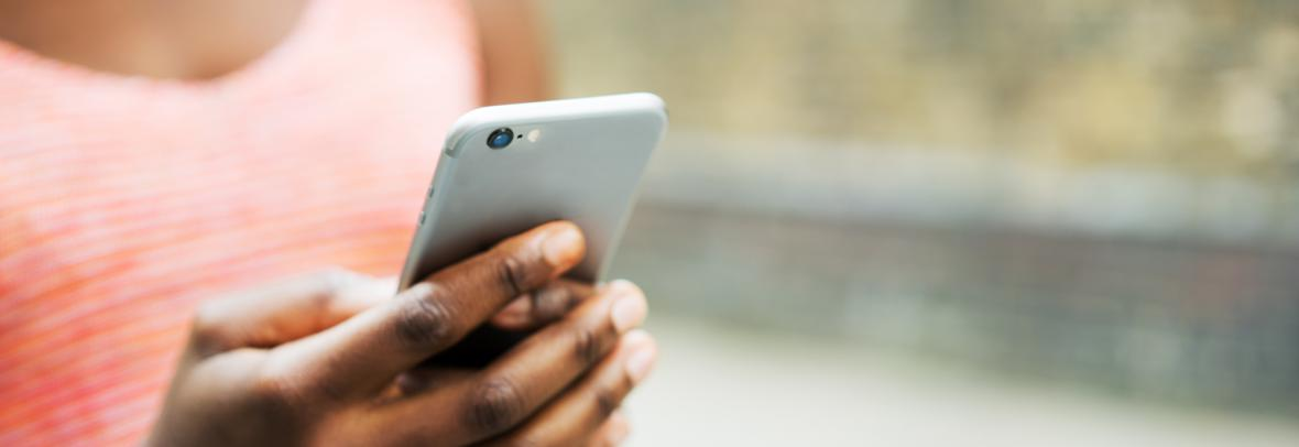 closeup of person's hand holding a cell phone