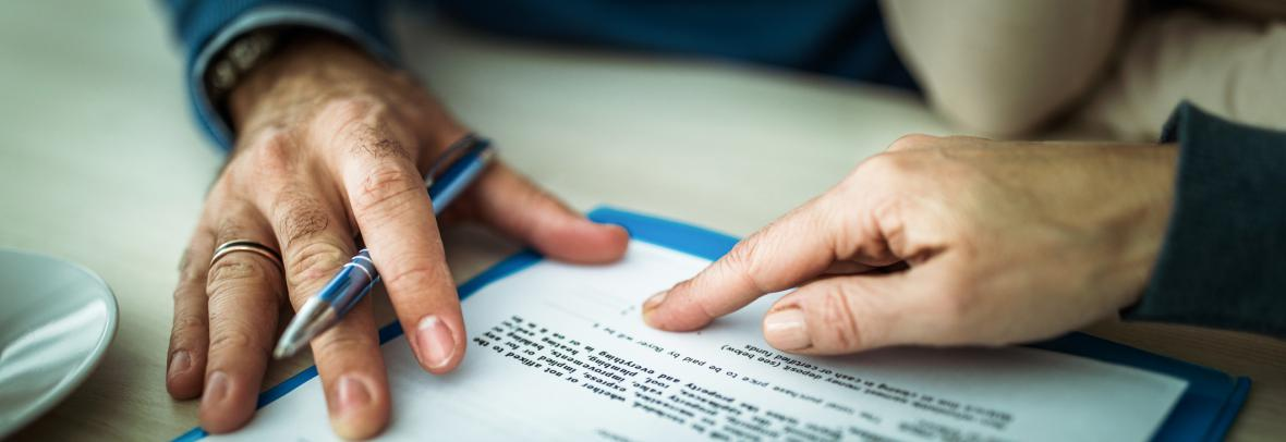 Hands on legal paperwork