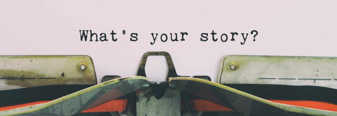 "typewriter with words ""what's your story?"""