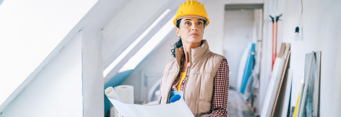 Woman studies chart during drywall installation