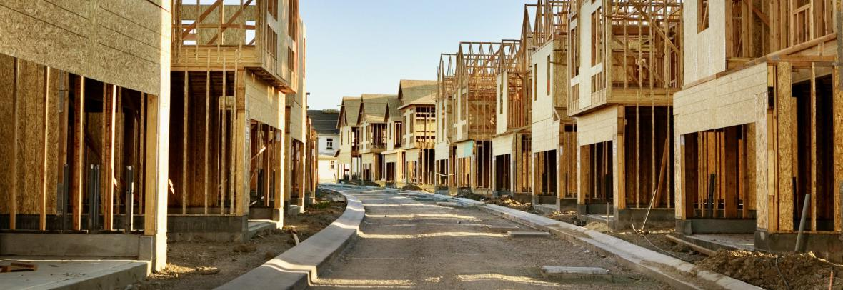 Street lined with homes under construction