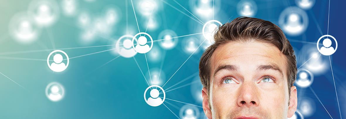 Man looking up at network of people