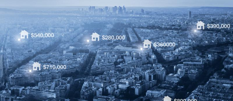 photo illustration of housing prices on aerial image of city