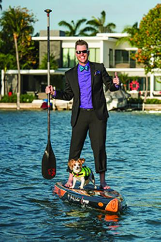 Nick Quay on his paddleboard with his dog